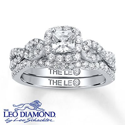 A 1/2 carat princess-cut center diamond is encircled by a host of round diamonds in this exquisite diamond engagement ring. Additional round diamonds line the 14K white gold band. The wedding band is beautifully contoured to complete the look and bring the total diamond weight to 1 1/8 carats. The ring is from The Leo Diamond® collection. Diamond Total Carat Weight may range from 1.115 - 1.14 carats.