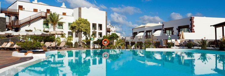 Poolområde på Dream Gran Castillo Resort på Lanzarote, De Kanariske Øer 30k i marts