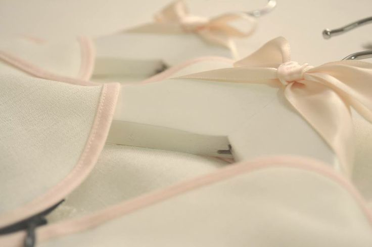 Ladey is all about the ladylike details! Here's a sneak peek at the finishing touches on a couple of Ladey dresses en-route to their new home—carefully packaged in custom-made Ladey garment bags, complete with signature white hangers and pale pink bows.