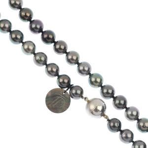 A Tahitian cultured pearl single-row necklace and ear pendants.