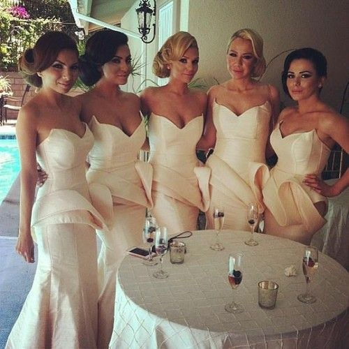 Love the color of these bridesmaid dresses! And the neckline. Not sure about that peplum thing.