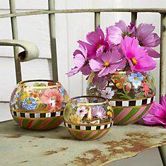 Heirloom Glass Globe Vases from MacKenzie-Childs are a lovely hostess gift.