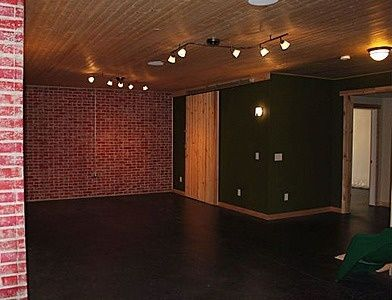 Poured basement painted to look like brick concrete for Poured concrete basement walls