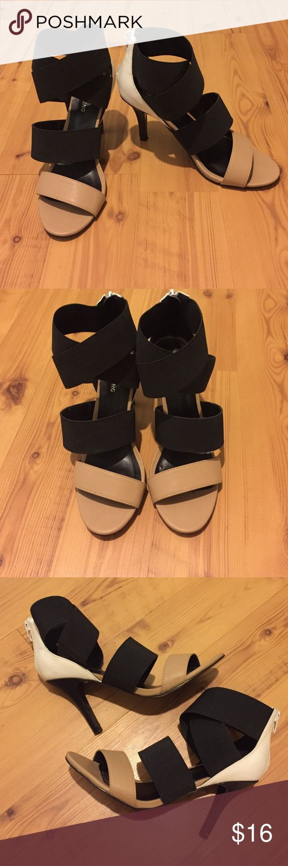 Call It Spring tan, black, and white strappy heels Tan, black, and white strappy Call It Spring heels. Worn once for graduation. Comfy and stylish. Make an offer! Call It Spring Shoes Heels