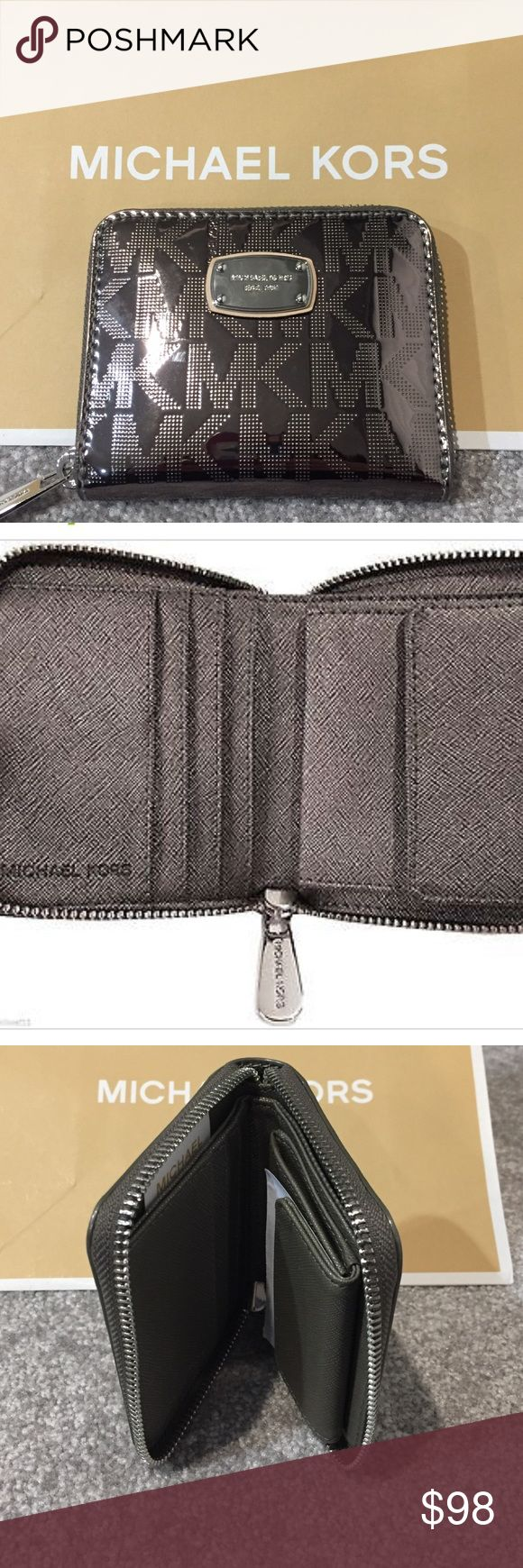 """MICHAEL KORS JET SET BIFOLD WALLET NICKEL NWT MICHAEL KORS JET SET BIFOLD WALLET NICKEL NWT.                                                                                                               Signature Nickel Mirror PVC Exterior Zip Closure Wraps Around Three Sides MK Nickel Silver Metal Logo Plate Polished Silver color Hardware Matching Textured Leather Interior  Lined in MK Custom Gray Sateen Four Card Slots  Currency Pocket Coin Purse has Snap Closure Dimensions : 4"""" W, 3.5"""" H…"""