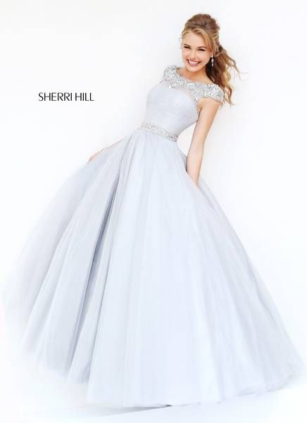 I love the look of this ball gown! It's so beautiful! Well, all of Sherri Hill's dresses are amazing, but this one especially strikes me as stunning. This is yet another dream dress of mine. :)