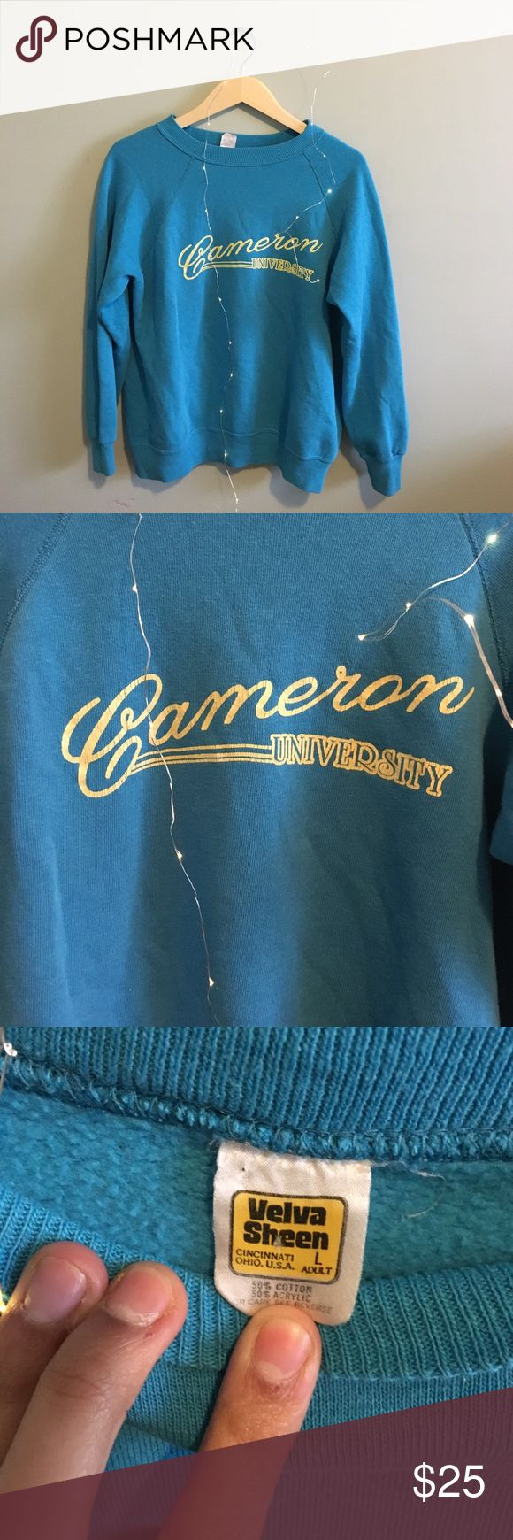 Vintage Cameron University Sweatshirt Lightly/vintage worn extremely soft sweatshirt. Size L but could fit any size in my opinion. Light yellow lettering that says Cameron University. Too cute! Vintage Tops Sweatshirts & Hoodies