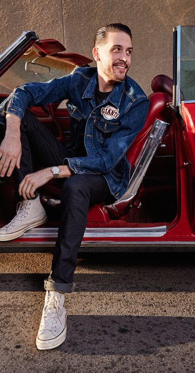 Bay Area proud. California bord-and-raised rapper G-Eazy wears our limited-edition denim SF Giants Trucker Jacket with dark denim and white Converse sneakers.