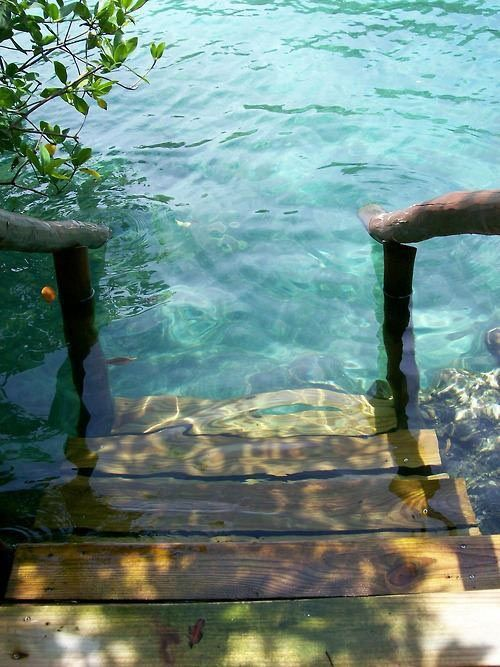 Stepping into crystal clear water...