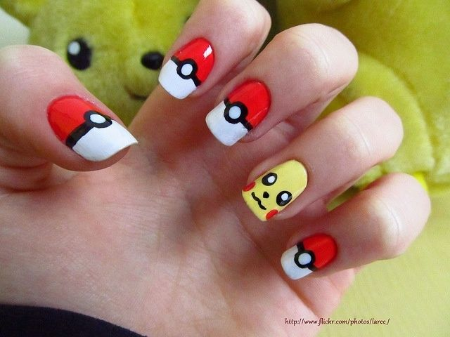 Pokey ball and pikachu nails. I'm so doing these when i get home. ill post a picture of my results.