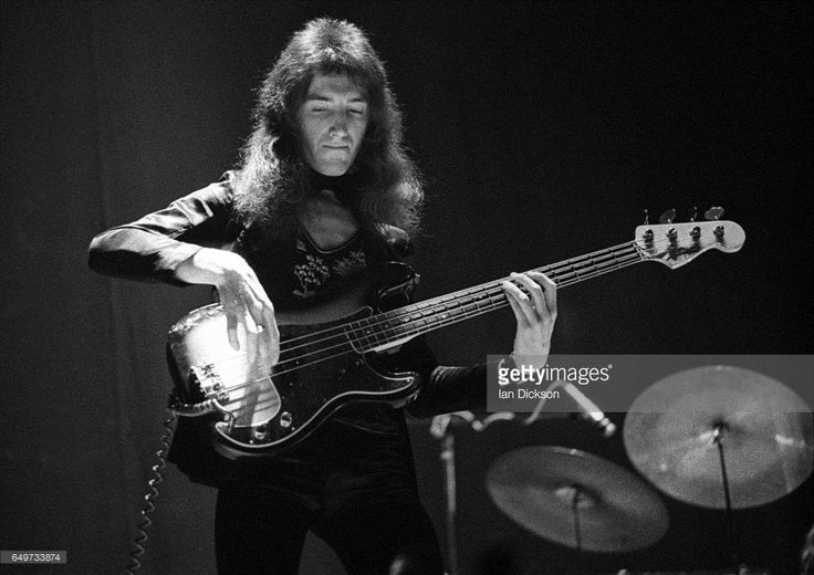 John Deacon of Queen performs on stage on the 'Queen II' tour, Rainbow Theatre, London, 31 March 1974.