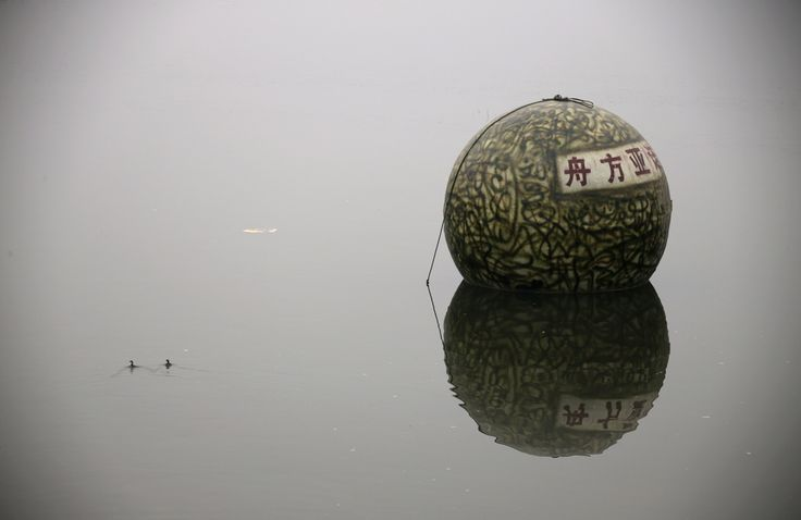 "A spherical pod, named ""Noah's Ark"", designed by Chinese inventor Liu Qiyuan floats on a river during a test in Xianghe, Hebei province, on December 12, 2012. Liu, who has spent 1.8 million yuan ($288,000) on building six ""Noah's Ark""s in 8 months with the help of his former furniture factory's workers, is working on his seventh pod. The 17 cubic-meter volume vessels were built to serve as lifeboats in the event of earthquakes, tsunamis and floods."