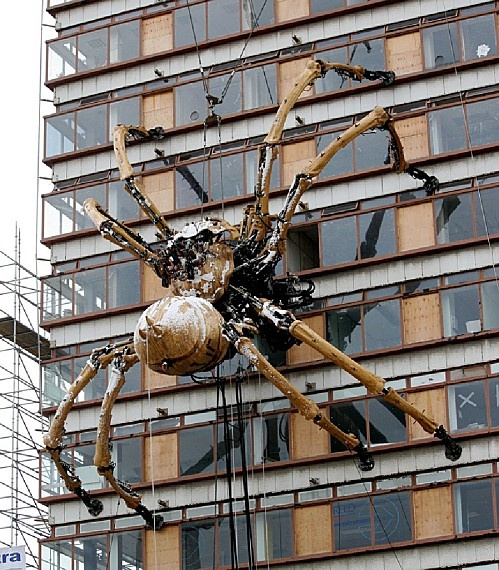 The giant spider from Royal Deluxe (#Nantes) on a building in #Liverpool. Photo: malarkey