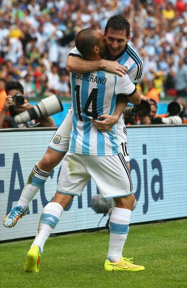 Lionel Messi of Argentina celebrates scoring his team's second goal and his second of the game with Javier Mascherano during the 2014 FIFA W...