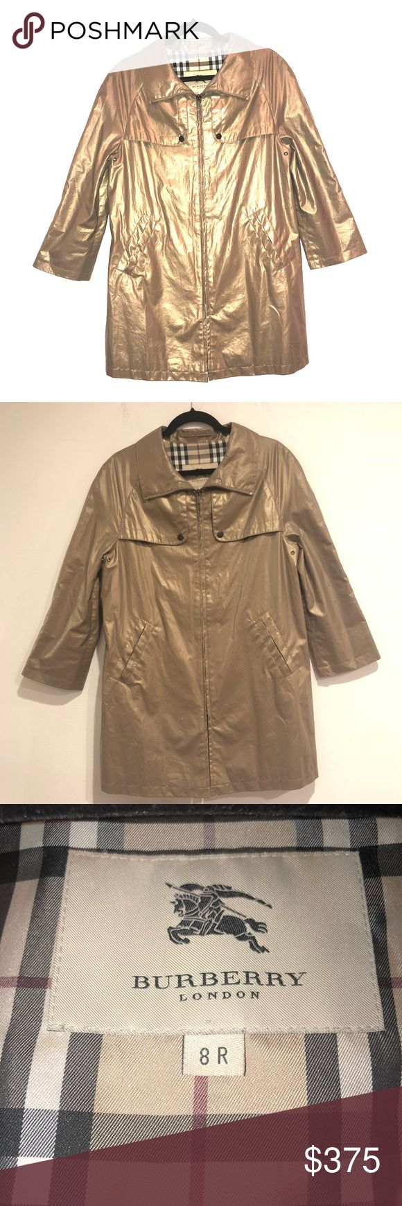 Burberry London Metallic Gold Rain Coat Woman's 8 Burberry London Light Weight Rain Coat in Metallic Gold/Taupe. Lightweight zip up jacket.  Seasonal Burberry Jacket. Jersey inside with classic Burberry print. Small stain on inside not noticeable. Burberry Jackets & Coats