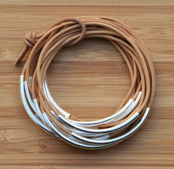 These fun bangles are made of natural Greek Leather cord. The leather is very soft!! The set contains 12 bangles, each with a Silver plated tube.