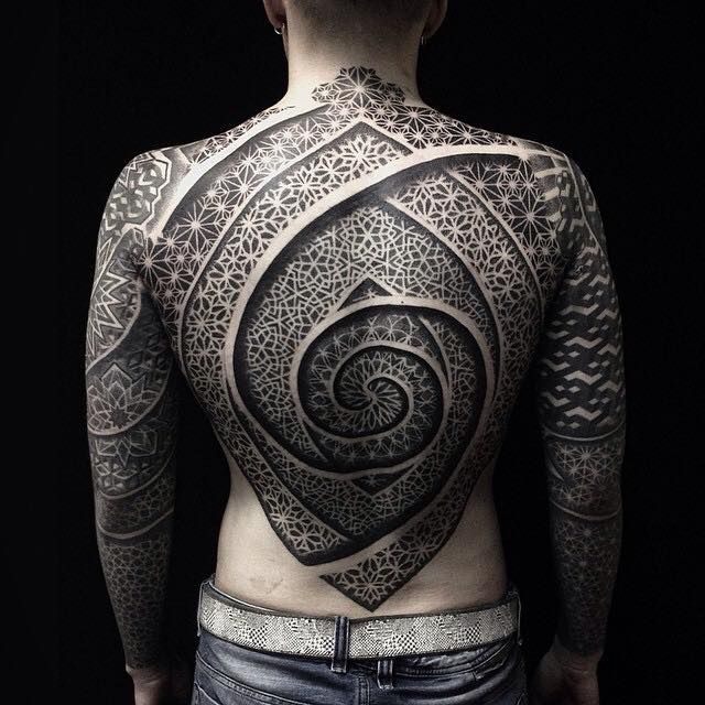 This Tattoo Artist's Incredibly Detailed Sacred Geometry Tattoos Will Blow Your Mind