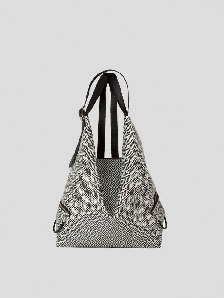 Côte&Ciel Ganges S Optical rucksack in black and white herringbone weave. Ganges is an ergonomically designed backpack for women inspired by the Furoshiki.