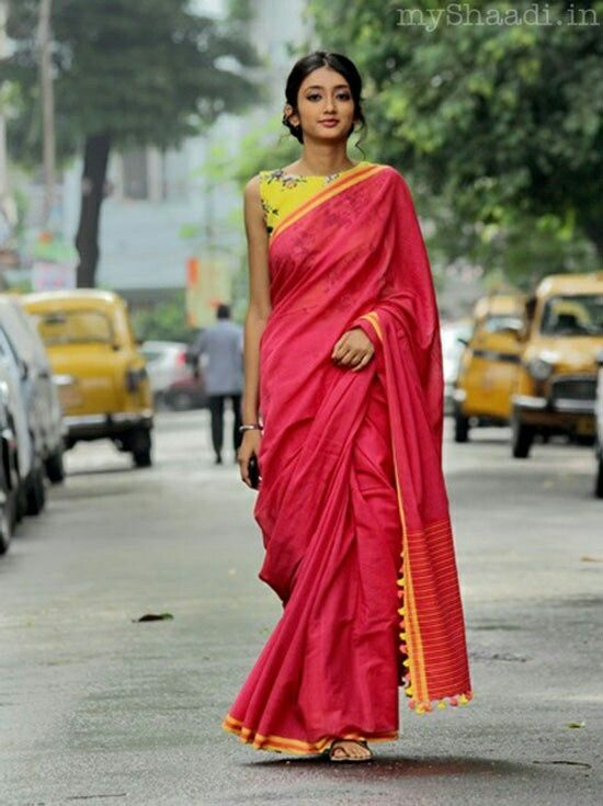 Saree with blouse. I like it. Except for the tassels. To me, little tassels like that look like they belong on a bedspread.