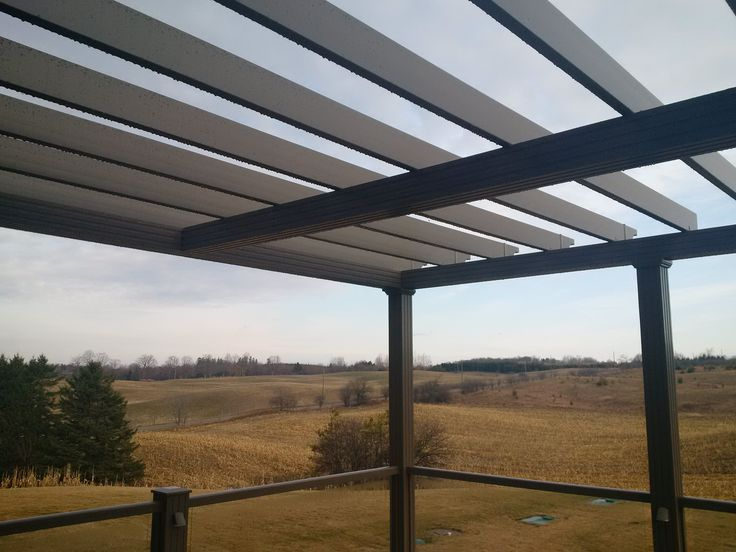 """Craft-Bilt products: aluminum decking & railing, LED sconce lights, our extruded vinyl pergola beams and a custom pergola frame made with our 5½"""" columns & beams."""