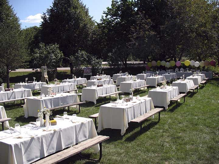 Charming Picnic Tables With White Linens