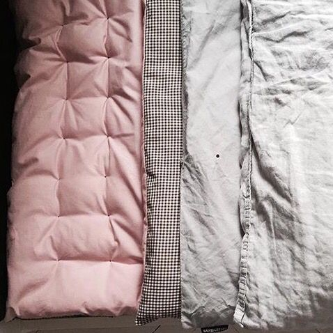 Multipurpose mattress cover, play mat, warm blanket...100% cotton with poly filling.One side light pink, other light brown checked. Wash on low temperature. Tumble dry low.