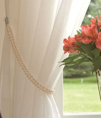 Went to Country Curtains for the first time...fell in love every time I turned around.  I loved this.  I have a silk drape up now, so I went to Target & bought 4 strands of pearls for $12....Looks awesome!