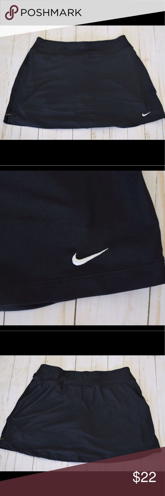 Black Nike Tennis Skort Excellent condition. Worn one time. Has Shorts underneath. Super comfy! Size M (8-10) Nike Skirts