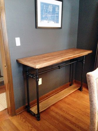 2013 TOH Don't Buy It, DIY It! Contest   This Old House Table made from old pipe fitting spray painted black.: