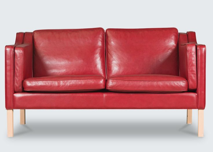 Beautiful 2-seater sofa in the quintessential Danish style of the 1960s. Featuring a stand-out thick, cherry-red leather and light beech legs. A matching 3-seater sofa is also available, each are sold separately.