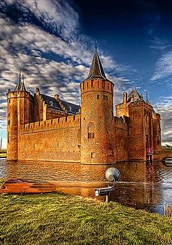 Castle Muiderslot in the Netherlands, located at the mouth of the river Vecht, some 15 kilometers southeast of Amsterdam, in Muiden, where it flows into what used to be the Zuiderzee. It's one of the better known castles in the Netherlands and has been featured in many television shows set in the Middle Ages