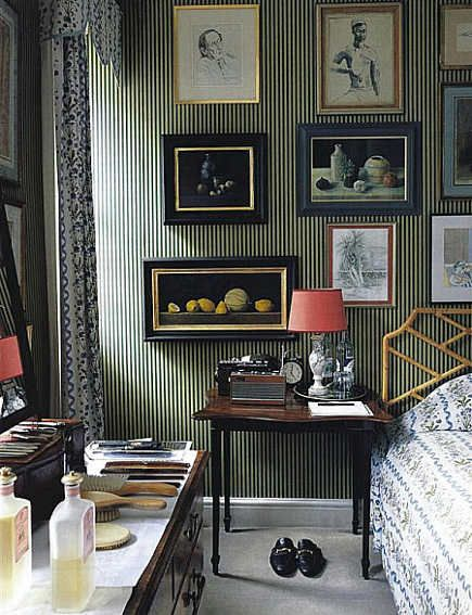 traditional bedroom--striped wallpaper, art gallery wall, bamboo headboard
