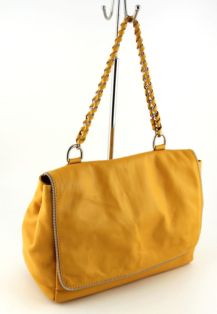 Trieste Giallo. Half zipper around the front.  Ultra soft leather.