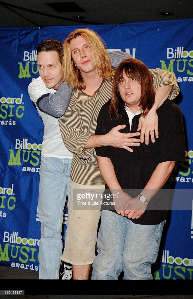 Mike Malinin, John Rzeznik, and Robby Takac of alternative rock band The Goo Goo Dolls stand next to each other at the 1995 Billboard Music Awards December 6, 1995 in New York City.