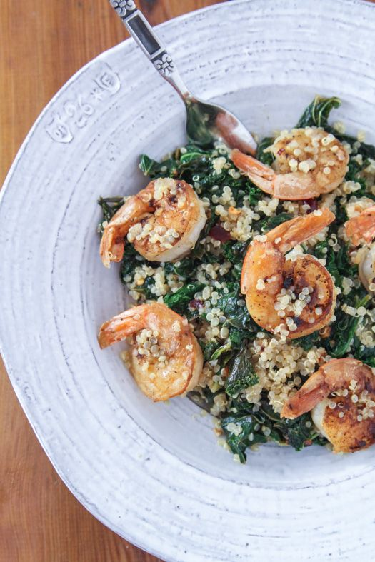 Garlic, lemon, and red pepper kale with shrimp and quinoa. A meal packed full of veggies and protein!