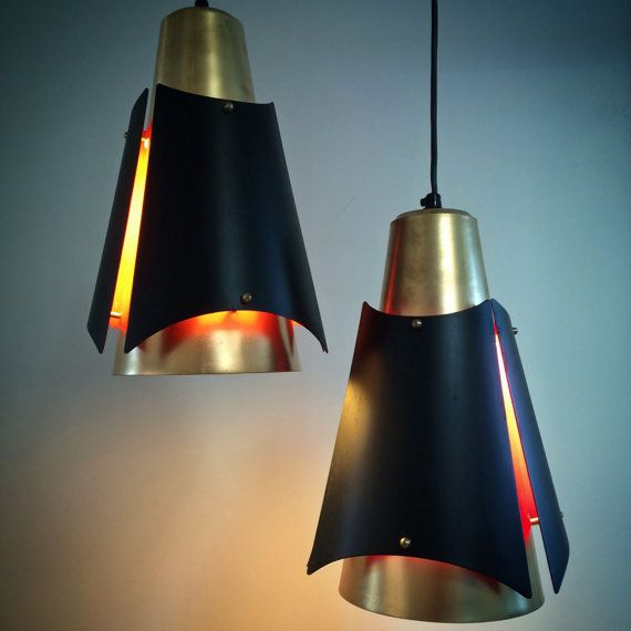 Astonishing pendant Oesterport by danish designer Bent Karlby. Made in the 60s for manufactor Lyfa. The copper and black shade looks amazing and is a