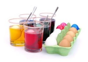 Kool-aid or vinegar and food coloring methods.  If the kids lightly crack the eggs before putting them into the dye, the eggs will also be colored with spider-web like lines.