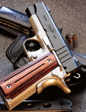 Kimber Aegis - 1911 style in 9mm. How friggin' goreous is this pistol?!