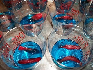 "Swedish Fish candy with blue jello.  A fun idea for a Dr. Seuss party.  You can write ""One fish, two fish, red fish, new fish"", on the outside of the clear cups."