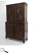 A Colonial rosewood sunburst cupboard or almirah, with four shutters and four shelves inside. 48 in L x 18.3 in B x 75.2 in H (approx)     46 x 46 in