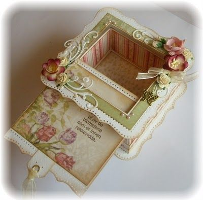 Absolutely beautiful box with sliding lid.  The instructions are in Norwegian, but I think I can figure it out.  :)