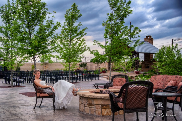 """This is one of my first experiences with an outdoor bridal where rain threatened. From then on, I decided I'd take my chances! So many people think that the bridal gown must be 85% of the image. I do that. But, I also love the big picture. An image like this can live above the couch for decades. The 85% image gets to look """"a little last year"""" after the wedding without a dramatic pose. This was from a bridal I shot at the Ruthe Jackson Center garden in Grand Prairie, Texas."""