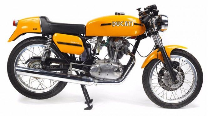 """Desmo"" is short for desmodromic distribution, which Fabio Taglioni introduced in Ducati motorcycles almost twenty years before the Ducati 250 was launched in 1971: a special system in which exhaust and intake valves are controlled both in the opening and closing strokes, instead of relying on spring recovery. The motorcycle portrayed in our gallery was manufactured by the Borgo Panigale company in 1974, and belongs to the second series of the Desmo range, which was introduced in 1972 ."