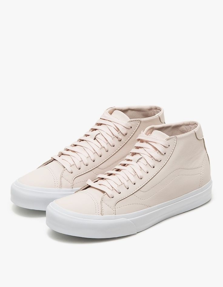 From Vans, a mid-top sneaker in Pale Pink. Lace-up front