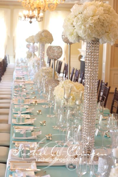 Stylish Weddings | Rachel A. Clingen Wedding & Event Design. Love the skinny tall vase, fill with a carnation bubble and tealights and pictures