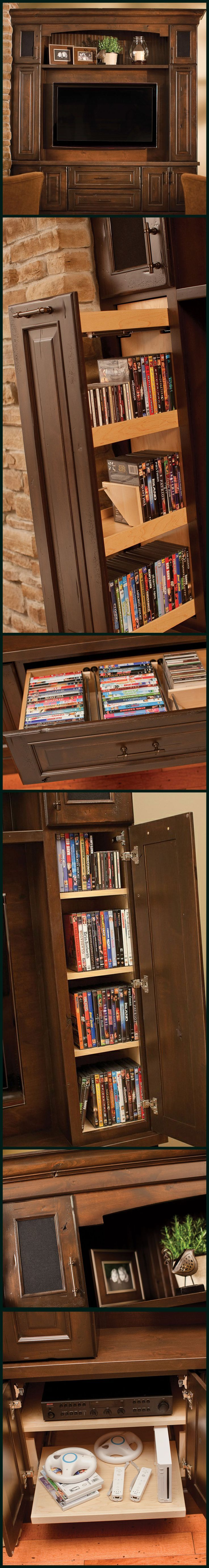 Think out of the box and design an Entertainment Center with storage for your whole family! Surround system & Speaker storage, game system roll-out shelves, pull-out media organizers, DVD & CD drawers, decorative storage, and so much more! - Dura Supreme Cabinetry.
