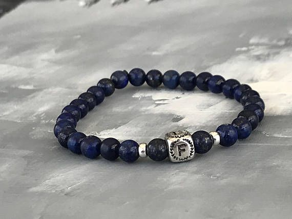 Men' s Beaded Bracelet (6.5mm round Lapis) Featuring 3 accents of 925 sterling silver . Pick the initial you want.