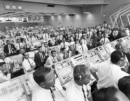 The Apollo 11 flight crew in the NASA control room