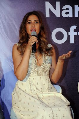 Nargis Fakhri Looks Hot in a White Dress At The Launch Event of Her Own App in Mumbai
