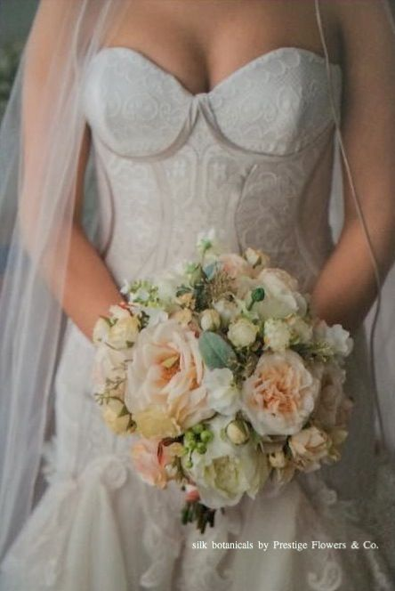 Silk bouquet: peony, garden roses, dahlia buds, gypsophila, sweet pea, berries, in apricot-peach colour palette. By Prestige Flowers & Co.